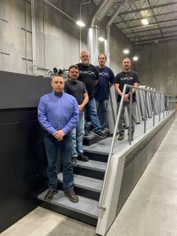 Kumon team members stand with the new Heidelberg Speedmaster XL 106. From left: Tom Mock, Bill Hartig, Joe Cosgrove, Lee Davis, and Jake Backscheider.