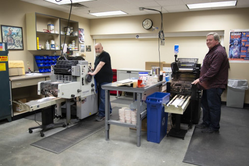 Mike Grush (left) and David Hoffman run the in-plant's two remaining Ryobi offset presses.