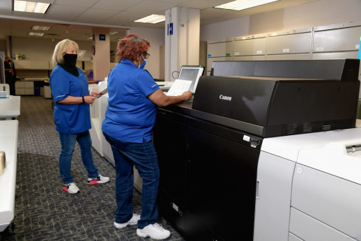 Shirley Downey (left) and Helen Lindley run the Canon imagePRESS C10000VP in the Dallas operation.