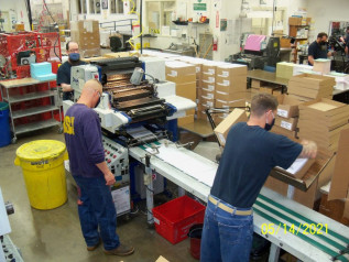 Envelope printing makes up a large percentage of the operation's work. Here, AICs run one of the shop's two Diamond P7 envelope presses.