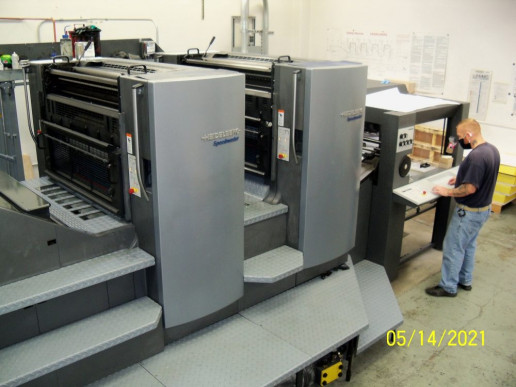 An AIC runs the in-plant's two-color Heidelberg press.