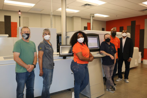 The BlueCrest AcceleJet inkjet press replaced four toner devices at the in-plant. From left: Jim Ryan, Karen Canary, Keyiera Bonds, Carl Ivey, Urial Hawkins, and Willis Jones.