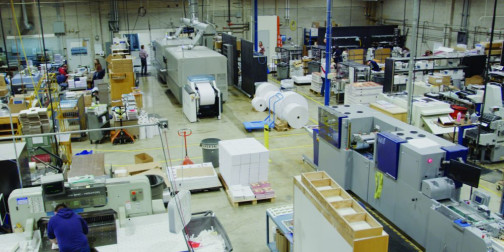 BYU Print and Mail's spacious 150,000-sq.-ft. facility is packed with printing and binding equipment.