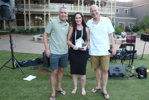 Accepting the award for the best case study for the transaction segment was Tonya Powers (center) of Canon Solutions America. Awards were presented by David Pesko (left) and Marco Boer.