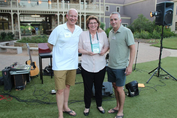 The Overall Contributing Attendee Award went to Cheryl Kahanec (center), CEO of Quantum Group. With her are Marco Boer (left) and David Pesko.