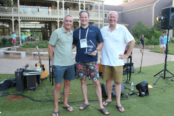 Accepting the award for the best case study for the publishing segment was Andy Fetherman (center) of Muller Martini. Awards were presented by David Pesko (left) and Marco Boer.