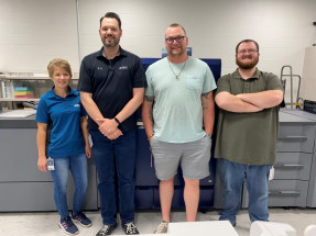 EMC Insurance relies on this Konica Minolta C12000 to keep up with the company's printing needs. Standing with it are Amy Cawthorn, Nate Riggins, Mike Slootheer, and Scott Crooks.