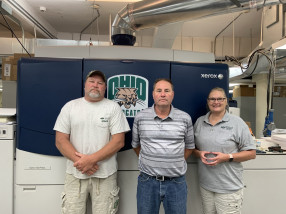 This Xerox iGen 150 at Ohio University, along with a Xerox Iridesse, is serving the in-plant well. With it are (from left) Dave Heightland, Blaine Gabriel, and Barb Dane.