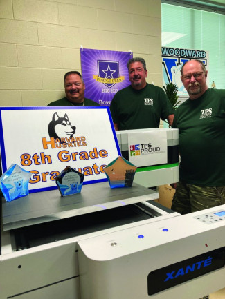 Showing off items printed on the new Xanté X-33 at Toledo Public Schools Duplicating and Mailroom Services are (from left) Doug McClure, Kevin Giles, and Steve Grab.