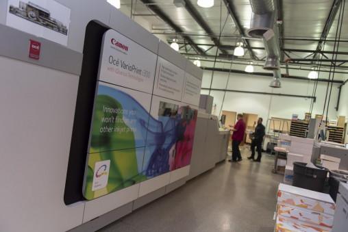 DuWane Sessions (left), digital print technician team lead, and Don Guldan, prepress technician, run the Canon varioPRINT i300 production inkjet press in Marshfield Print & Mail Services' 30,000-sq.-ft. operation.