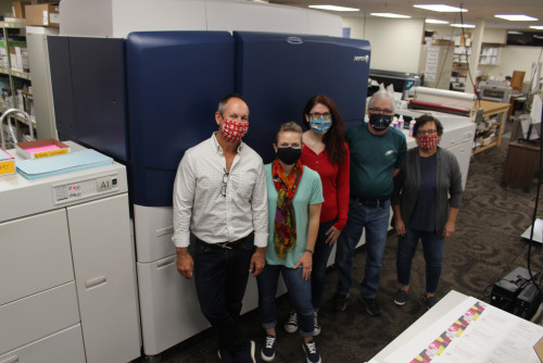 Dickinson College Print Center staff stand with their Xerox iGen 5.