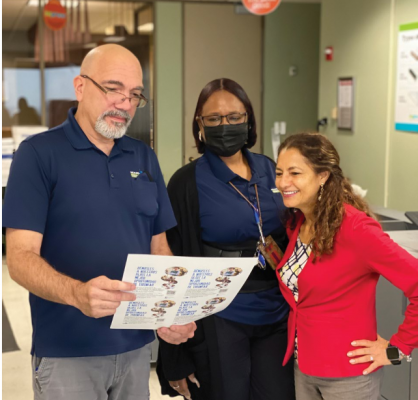 From left: Andy Rogers, Laletrice Gavins-Litmon, and Maria Victoria Clavijo review a proof printed on the Konica Minolta AccurioPress C14000.