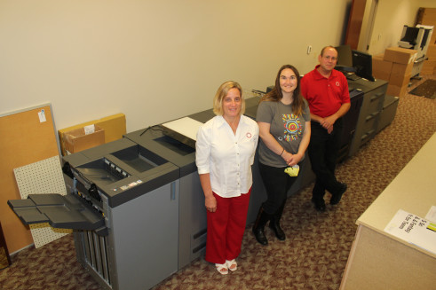 Dauphin County Library System Administrative Offices staff with the in-plant's new Konica Minolta AccurioPress C4070.
