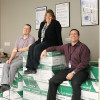 Tami Reese (center), operations manager at the Intermountain Design & Print Center, is flanked by Simon Ortiz (left), Ricoh site manager, and Rich Bott, supply chain services director.