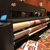 EFI debuted its largest soft-signage printer, the 5.2-meter EFI VUTEk FabriVU 520.