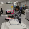 Inside EMC Insurance Companies' new print facility, Carla Hines runs the Xerox Color 1000
