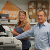 The Fenway Group's Rick Sands and Renee Lawn stand with one of their Canon imagePRESS C10000VP's.