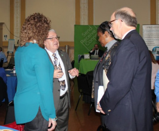 California State Printer Jerry Hill (second from left) talks with GPO officials Sandra MacAfee, Davita Vance-Cooks and Andy Sherman.