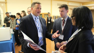 Rob Piersielak of Xerox talks with print managers from the U.S. House of Representatives.