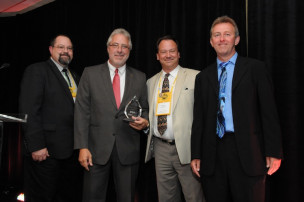 OU's John Sarantakos (second from left) accepts the Attendees' Choice award during the IPMA awards ceremony from Mike Lincoln, Chris Kohler and Bob Neubauer.