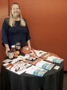 Theresa Hatcher, promotional product specialist at The University of Texas at Austin, shows off some of the promotional products the in-plant sells.