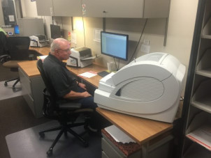 At DMBA Central Services, John Worsley operates the Kodak Ingenuity 9090DB scanner. To his left are the in-plant's two Fujitsu FI 6670A scanners, which handle OCR scanning.