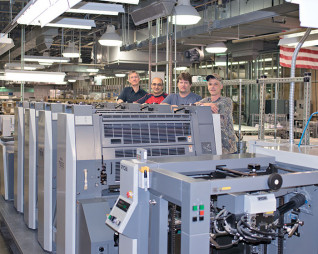 Offset printing is still a big part of the in-plant's business, generating 40% of its revenue. This prompted the shop to add a four-color, 23×29˝ Ryobi 764E press in 2015. With it are (from left) operators Larry Haag, Matt Seidel, Mike Robinson and Aaron Vanada.
