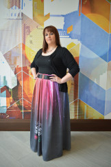 Liz Bowden shows off a skirt she sewed from fabric printed on a wide-format printer.