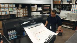 Victor Ramirez checks the output of a CTA Neighborhood Map produced on an HP DesignJet Z6100.