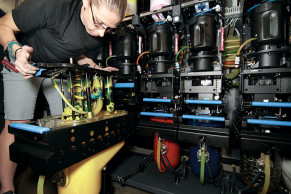 Operator Amber Guillory performs maintenance on the HP Indigo 10000.
