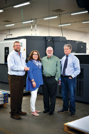 Standing with UNT's new HP Indigo 10000 are (from left) Clem Deussen, assistant director, Eagle Images; Lora Connaughton, director; Roy Nance, associate director; and Bernie Emmons, director of promotional sales.
