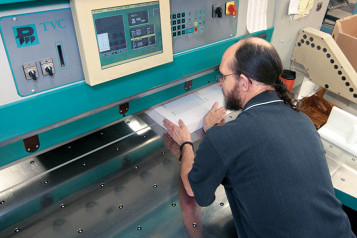 Randy Groves runs one of the in-plant's Perfecta cutters.