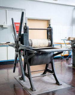 Historical hand press to print etchings at the vocational school.