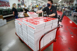 Employees at University of Nebraska-Lincoln Printing and Mail Services pack and ship boxes to graduates. (Photo by University Communications/UNL).