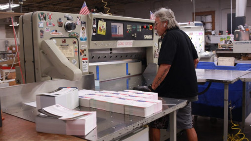 ABCO Printing's commitment to efficiency keeps finishing processes like cutting moving, despite a profusion of jobs.