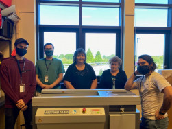 Standing with the new Duplo DB-280 perfect binder at Whatcom Community College are (from left) Dawson Willis, Nicolas Willis, Diane Cronk, Tatyana Leonova, and Isaac Cartagena.