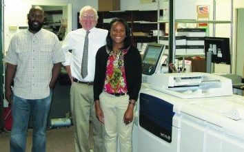 Standing with the Marist College Digital Publications Center's new Xerox Color J75 Press are (from left): Archie Chambers, Alex Podmaniczky and Tiffany Macdonald. Missing: Joe Carrubba.